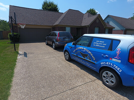 masters roofing service car