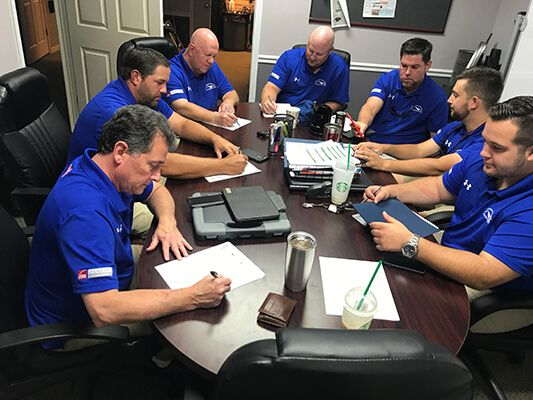 masters roofing team meeting